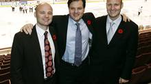 The Aquilini Investment Group owned by, from left Paolo, Francesco and Roberto Aquilini pose for pictures in GM Place. (CHUCK STOODY)