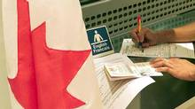 Filling out a Canadian visa application form. (AP)