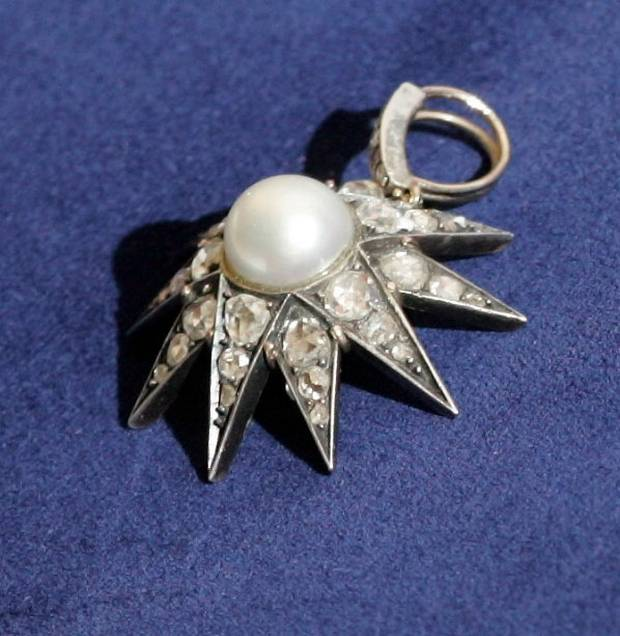 The antique Koechert Diamond Pearl, which was made for Queen Elizabeth of Austria in the 19th century, is shown at a police news conference in Winnipeg on Friday, June 1, 2007.