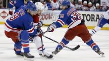 New York Rangers defenseman Kevin Klein (8) and right wing Mats Zuccarello (36) battle Montreal Canadiens center Daniel Briere (48) for the puck during the first period in Game 6 of the NHL hockey Stanley Cup playoffs Eastern Conference finals, Thursday, May 29, 2014, in New York. (Associated Press)