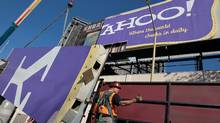 A worker moves a section of a Yahoo! billboard onto a truck on December 21, 2011 in San Francisco, California. (Justin Sullivan/Getty Images)