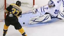 Toronto Maple Leafs goalie James Reimer (R) makes a save on Boston Bruins' Patrice Bergeron during the second period of Game 5 of their NHL Eastern Conference quarter-final playoff series in Boston, Massachusetts May 10, 2013. (BRIAN SNYDER/REUTERS)