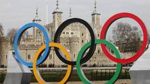 Olympic rings are mounted on a barge on the River Thames in London, Feb. 28, 2012. While Canadian broadcasters bide their time, waiting to see whether NHL players will participate in the 2014 Winter Games in Sochi, Russia, Yahoo Inc. is reportedly considering a bid for Canadian broadcast rights for event. (ANDREW WINNING/REUTERS/ANDREW WINNING/REUTERS)