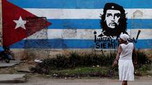 A wall is covered with a mural of the Cuban flag and an image of Cuba's revolutionary hero Ernesto (Che) Guevara in Havana. (FRANKLIN REYES/ASSOCIATED PRESS)