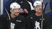 Daniel Sedin #22 and Henrik Sedin #33 of the Vancouver Canucks share a laugh during a practice session with the UBC Thunderbirds hockey team at the University of B.C. in Vancouver January 7, 2013. (Jeff Vinnick For The Globe and Mail)