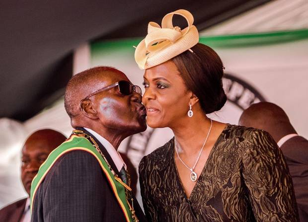 Zimbabwe President Robert Mugabe kisses his wife and first lady Grace during during the country's 37th Independence Day celebrations at the capital, Harare, in April. Her unpopularity may drive voters to opposition camps, a senior member of a rival party says, as she is 'the most hated woman in Zimbabwe.'