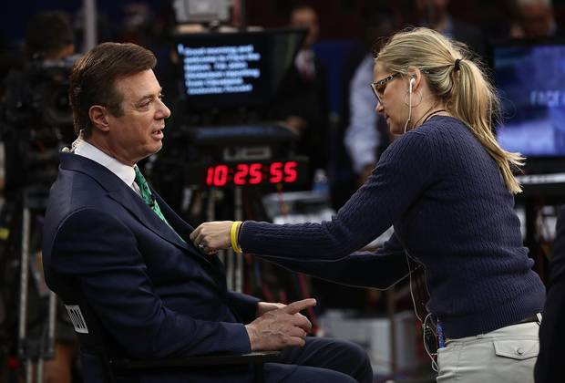 Paul Manafort prepares for an interview on the floor of the Republican National Convention at the Quicken Loans Arena in July.