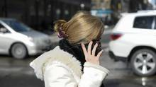 Various photos of people using their mobile devices for phoning and texting in downtown Toronto on Feb 22 2011 (Fred Lum/The Globe and Mail/Fred Lum/The Globe and Mail)