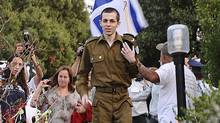 Sgt. Gilad Shalit arrives at his home in the northern village of Mitzpe Hila in this handout released by the Israeli Defence Forces on Oct. 18, 2011. (Reuters)