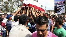 Lebanese Army soldiers and relatives of Alawite soldier Ali Khaddaaro carry his coffin during his funeral in Talhmera village, Akkar August 5, 2014. (REUTERS)