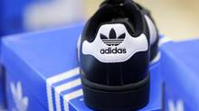 Adidas has urged sub-contractor Panarub to re-open discussions with its union after 13 people were injured during a walkout. (MICHAELA REHLE/REUTERS)