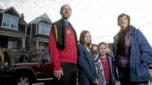 TORONTO: JANUARY 7, 2012 - Alexandra Macqueen poses for a photograph with her husband, Warren Huska, and their two children, Lark, nine, and Frances, seven, outside of their Ashdale Avenue home in Toronto on Saturday, January 7, 2012. Macqueen, a certified financial planner, coauthored a book called Pensionize Your Nest Egg. (Matthew Sherwood/The Globe and Mail)