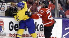 Team Sweden defenceman Fredrik Styrman (L) colllides with Team Canada forward Louis Leblanc (R) during the second period of their IIHF World Junior Championships pre-competition game in Toronto December 21, 2010. The IIHF World Junior Championships will be played in Buffalo, New York from December 26, 2010 to January 5, 2011. (MIKE CASSESE)