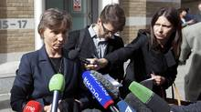 Marina Litvinenko speaks to members of the media as she leaves a hearing into the death of her husband, Alexander Litvinenko, in London September 20, 2012. (NEIL HALL/REUTERS)