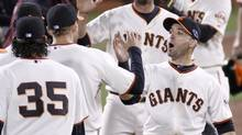 San Francisco Giants second baseman Marco Scutaro (R) celebrates defeating the St. Louis Cardinals with teammate Hunter Pence at the conclusion of Game 6 of their MLB NLCS playoff baseball series in San Francisco, October 21, 2012. (DANNY MOLOSHOK/REUTERS)