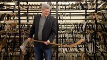Stephen Harper holds a hockey stick from the 1907 Stanley Cup final during a research visit to the Hockey Hall of Fame in Toronto, Canada, December 2011. (Simon and Schuster Canada/Handout)