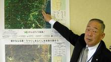 Hirono mayor Motohoshi Yamada points at his town on a map of Fukushima prefecture. Mr. Yamada believes radiation levels mean it's not yet safe for Hirono's 5,500 residents to return. (Mark MacKinnon/The Globe and Mail)