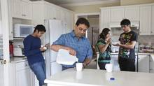 Yatin Shah (centre right), his wife Beena and sons Rocky, (centre left), and Sunny photographed in the family's Surrey home August 21st, 2009. The family will pay approximately $560 more per month on their expenses under the HST. (Brett Beadle for The Globe and Mail/Brett Beadle for The Globe and Mail)