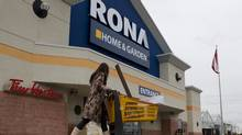 An unidentified customer walks out of a Rona store in Toronto's east end, Feb. 22, 2012. (Chris Young for The Globe and Mail/Chris Young for The Globe and Mail)
