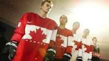 Youth players model the new Canadian Olympic team hockey jerseys as they are unveiled in Toronto, Tuesday, Oct.8, 2013. (Peter Power/The Globe and Mail)