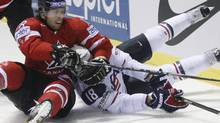 Canada's James Neal, left, collides with Mike Brown of the US, right, during their qualification round group F hockey World Championships match in Kosice, Slovakia, Friday, May 6, 2011. (AP Photo/Petr David Josek) (Petr David Josek)