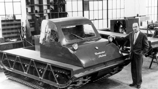Joseph-Armand Bombardier, designer of the Bombardier snowmobile, stands beside the latest model on the production line of his Valcourt, Que. factory in this 1960 photo.