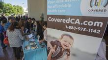 Americans sign up for health insurance in California at the launch of 'Obamacare.' (LUCY NICHOLSON/REUTERS)