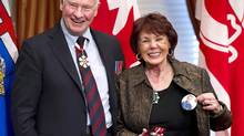 Colleen Klein, wife of former Alberta Premier Ralph Klein, shows a Klein election badge after accepting the Order of Canada from Governor General David Johnston on behalf of her husband in Calgary, Alberta on Tuesday, Nov. 13, 2012. (Larry MacDougal/THE CANADIAN PRESS)