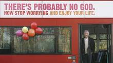 British author Richard Dawkins, who wrote The God Delusion, stands on a bus at the launch of an atheist advertising campaign, in London January 6, 2008. (Andrew Winning/Reuters)