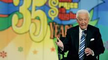 "Host Bob Barker answers questions on stage at a news conference after the taping of his final episode of the game show ""The Price Is Right"" in Los Angeles June 6, 2007. (FRED PROUSER/REUTERS)"