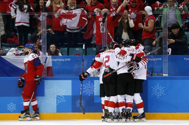 Feb. 24, 2018: Chris Kelly of Canada celebrates with teammates after scoring Canada's fifth goal against the Czech Republic in the bronze-medal Olympic men's hockey game.