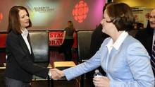 Wildrose leader Danielle Smith (L) and Conservative leader Alison Redford shake hands following a Leaders Forum at CBC in Edmonton April 19, 2012.