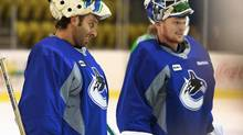 Vancouver Canucks goaltender Roberto Luongo (left) and teammate Corey Schneider listen to instructions during an informal skate at UBC in Vancouver, January 11, 2013. (Jeff Vinnick For The Globe and Mail)