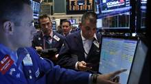 Traders work on the floor of the New York Stock Exchange (BRENDAN MCDERMID/REUTERS)