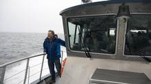 Brian Falconer of the Raincoast Conservation Foundation aboard the Tsimshian Storm near Prince Rupert, B.C. on Dec. 11, 2012. (Jonathan Hayward/The Canadian Press)