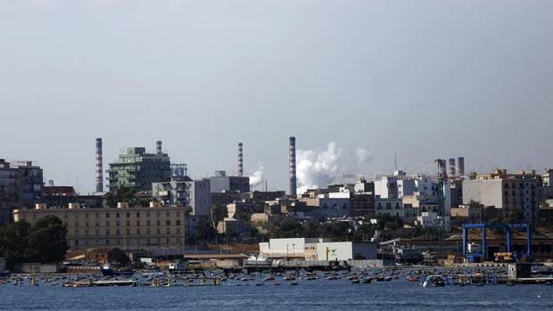 The ILVA steel plant in Taranto, Italy – the largest in Europe – is seen in this Aug. 5, 2012 photo. Italian group ILVA said it might have to close the plant after judges ordered the seizure of steel and semi-finished products as part of a corruption probe that saw several managers arrested on Monday. The arrests come after reports of an elevated incidence of cancer in the area possibly related to emissions from the plant. (Stringer/Italy/Reuters)