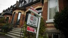 Mortgage insurance is required for all Canadians with less than a 20-per-cent down payment on a house who borrow from a federally regulated bank. (Tim Fraser For The Globe and Mail)