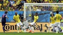 Netherlands' Daley Blind, left, scores his side's second goal during the World Cup third-place soccer match against Brazil at the Estadio Nacional in Brasilia, Brazil. (Hassan Ammar/Associated Press)