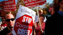 Activists protest outside Goldman Sachs's Washington, D.C., office. (Alex Wong/Getty Images)