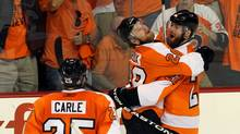 Ville Leino #22 of the Philadelphia Flyers celebrates with teammates Matt Carle #25 and Claude Giroux #28 after scoring a goal in the third period against the Chicago Blackhawks in Game Three of the 2010 NHL Stanley Cup Final at Wachovia Center on June 2, 2010 in Philadelphia, Pennsylvania. (Jim McIsaac/Getty Images)
