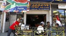 "Restaurant owner Yohannes ""Johnny"" Zerea stands outside the Rendez-vous on the Danforth, which has a thriving Ethiopian community near the intersection of Greenwood Avenue. (Deborah Baic/The Globe and Mail)"