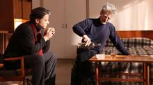 Paul Susser, left, played by Vincent Hoss-Desmarais, sits across from Beckett, played by Stephen McHattie. (Item 7 / TVA Films)