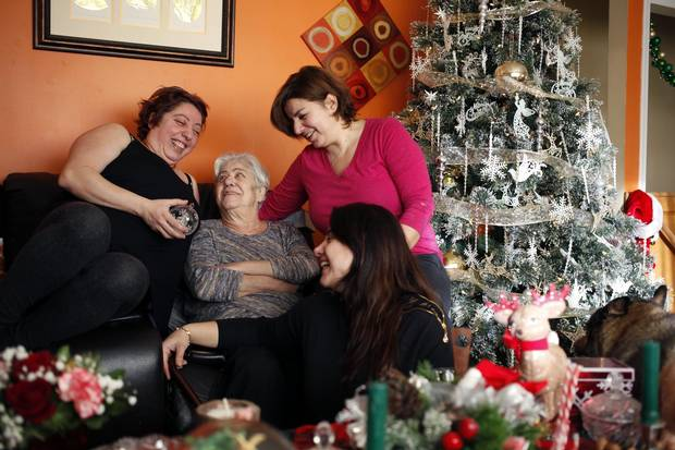 Merell Awad, left, with her mother Samira, and sisters Rania and Huda at home in Campbell River, B.C., on Dec. 20, 2017.