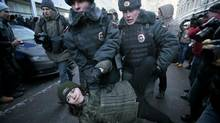 Police detain a gay rights-activist during a protest near the State Duma in Moscow on Jan. 25, 2013. (Mikhail Metzel/AP)