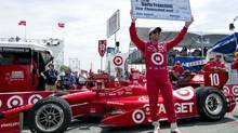 Scotland's Dario Franchitti celebrates gaining pole position during qualifying sessions at the Toronto Indy in Toronto on Saturday July 7 , 2012. (Frank Gunn/THE CANADIAN PRESS)