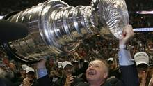 Anaheim Ducks' coach Randy Carlyle hoists the Stanley Cup after his team beat the Ottawa Senators in Game 5 of the 2007 finals. (Mike Blake/Reuters/Mike Blake/Reuters)
