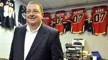 Jay Feaster leaves a local radio sports talk show after the Calgary Flames announced him as the new acting general manager of the team in Calgary, Alberta, December 28, 2010. Darryl Sutter who was the Flames' general manager for the past eight years was asked to step down today. (TODD KOROL)