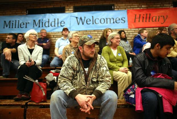 Hillary Clinton supporters look on during an event at BR Miller Middle School in Marshalltown, Iowa, on Jan. 26, 2016.