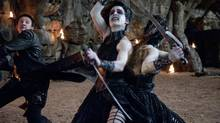 Jeremy Renner (left) as Hansel must fight a black witch (Famke Janssen) who doubles as a decomposing monster.
