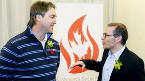 Former Colorado Avalanche goaltender Patrick Roy, left, chats with former Formula One champion Jacques Villeneuve ahead of the 2010 Canada's Sports Hall of Fame induction in Calgary on Wednesday Nov. 10, 2010.